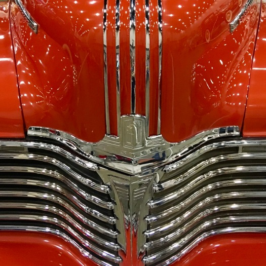 Red vintage car with chrome grille