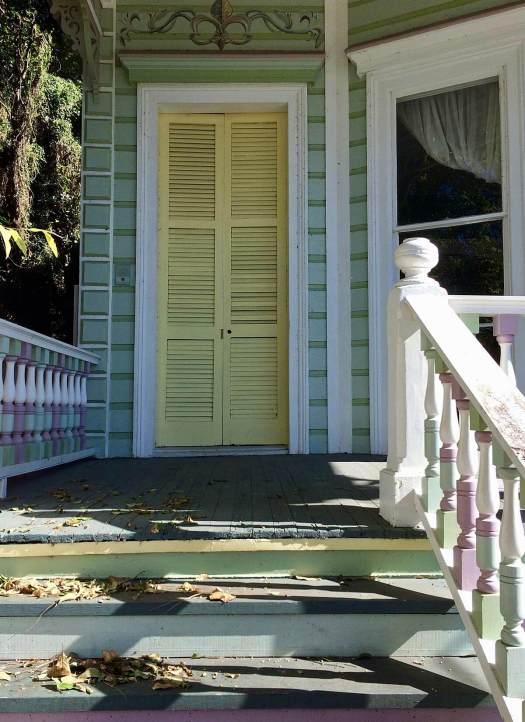 Green house with yellow door