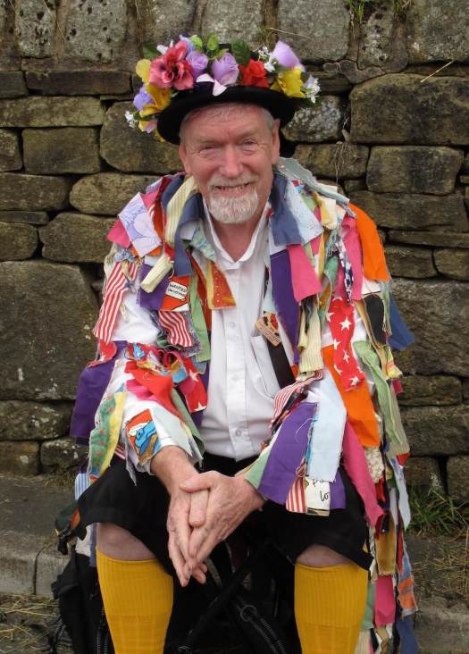 Morris man in a colourful ragged coat and flower hat