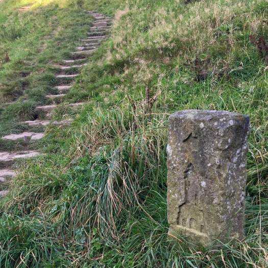 Stone marker points the way to Darwen Tower