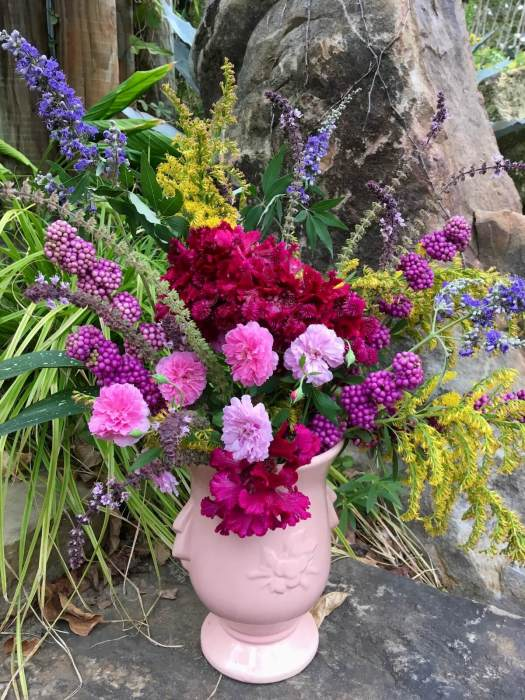 Flower arrangement with beautyberry, goldenrod, roses