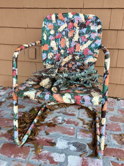 Metal chair painted in many colours