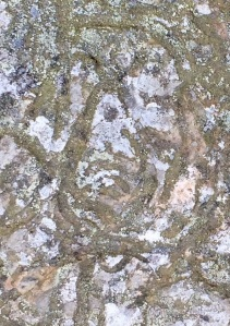 Alien carved on rock