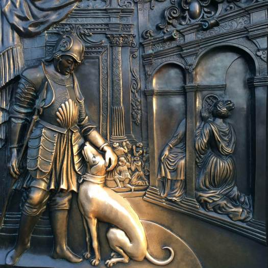 Dog on a panel rubbed gold by tourists, Charles Bridge