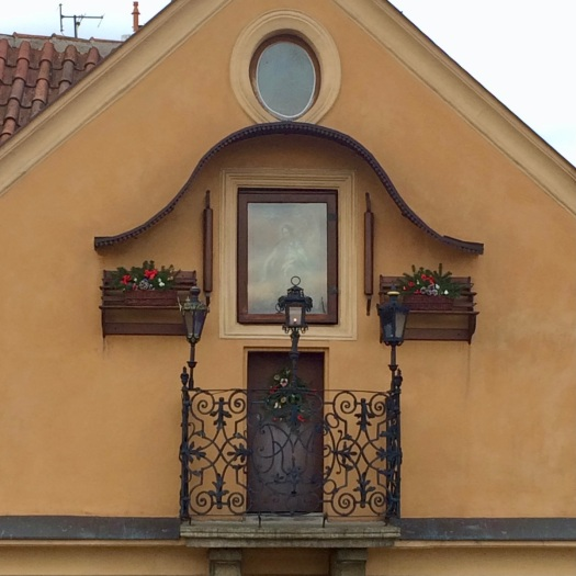 Tiny balcony on the end of a house in Prague