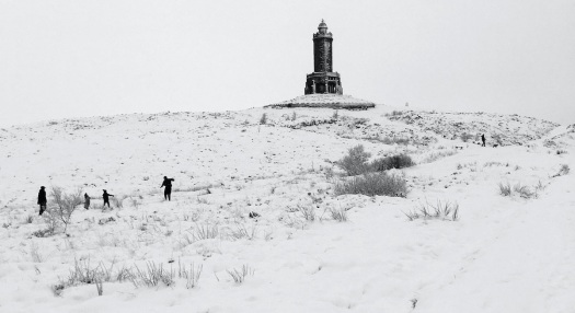 Walkers near Darwen Tower in the snow