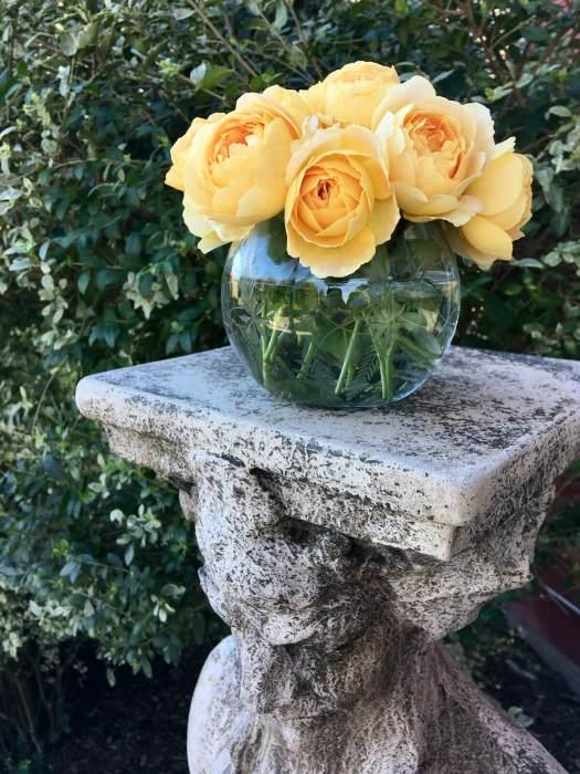 Rose posy on a decorative plinth
