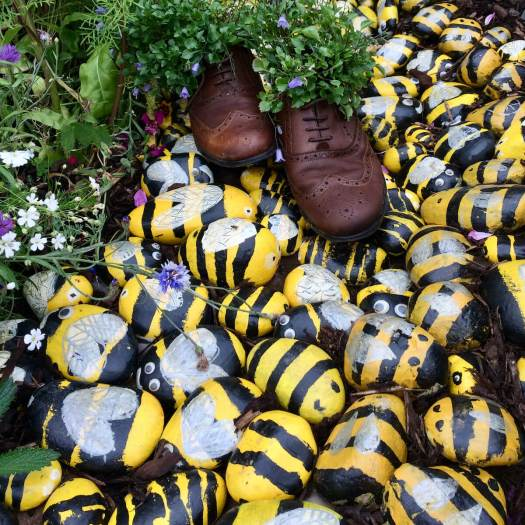 Stone bee garden mulch with shoe planters