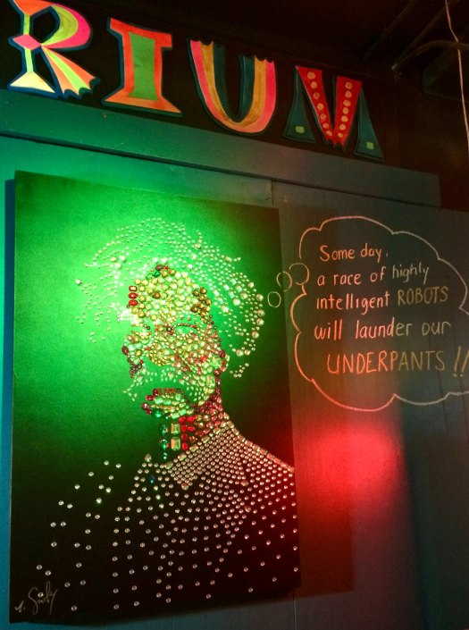 Einstein art with green and red light