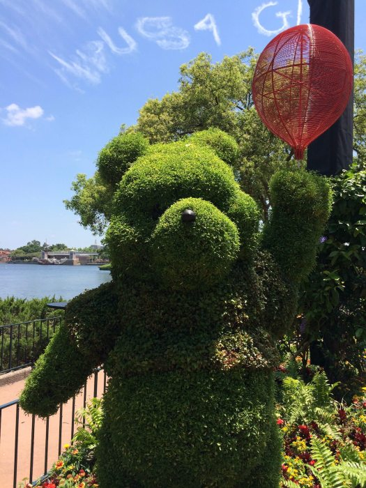Topiary Pooh bear with red balloon