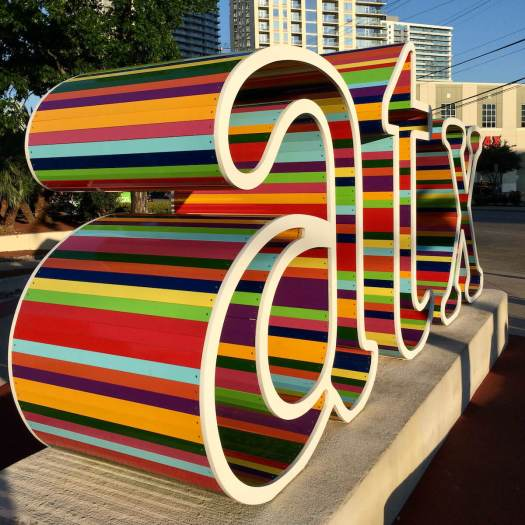 Whole Foods rainbow coloured atx logo in Austin