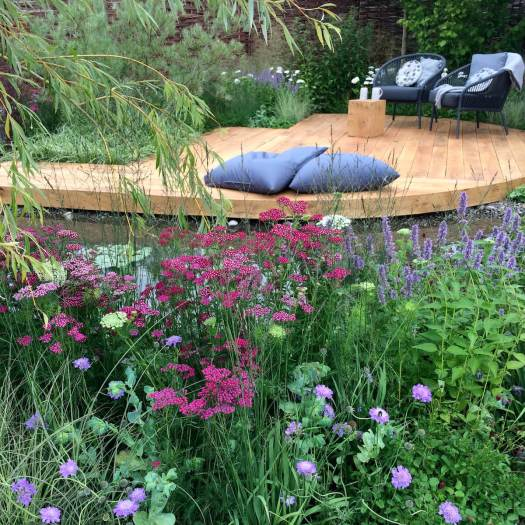 Raised by Rivers garden with flowerbeds and oak decking