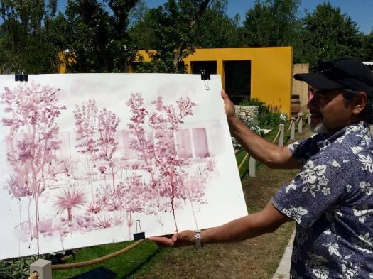 Artist with a painting of the Santa Rita garden at Hampton Court