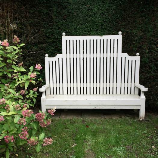 High-backed wooden garden bench, painted white