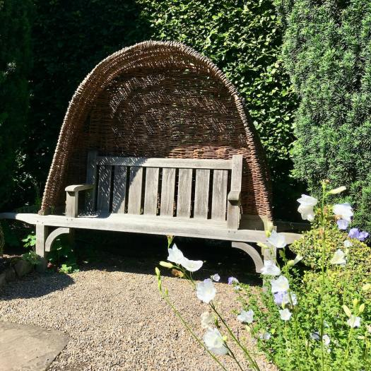 Wood and wicker Arts and Crafts style bench
