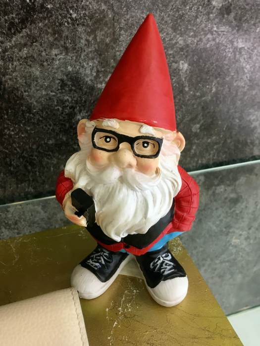 Gnome wearing glasses and Converse shoes