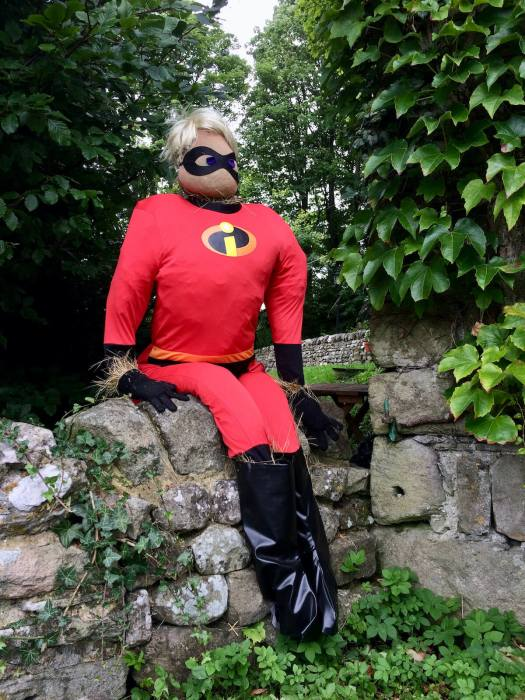 Mr Incredible scarecrow on a stone wall