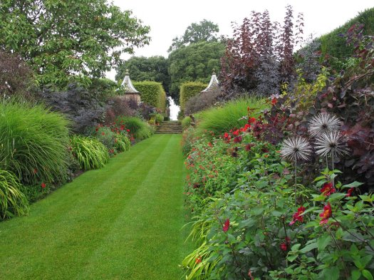 View down the double red borders at Hidcote