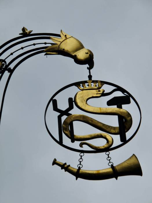 Zurich shop sign with snake and horn